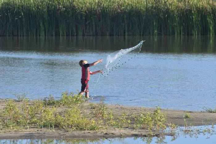Water One Person One Boy Only Child Outdoors Nature River Fishing Fishing Net Casting A Net EyeEmNewHerе