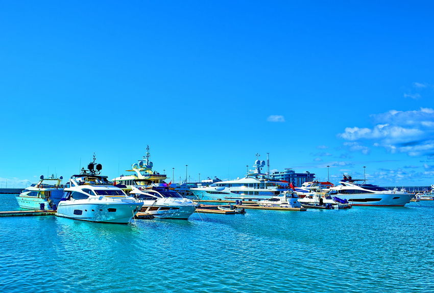 Nautical Vessel Sea Blue Water Transportation Sky Summer Harbor No People Outdoors Beach Day Tranquility Large Group Of Objects Moored Nature Vacations Travel Destinations Yacht