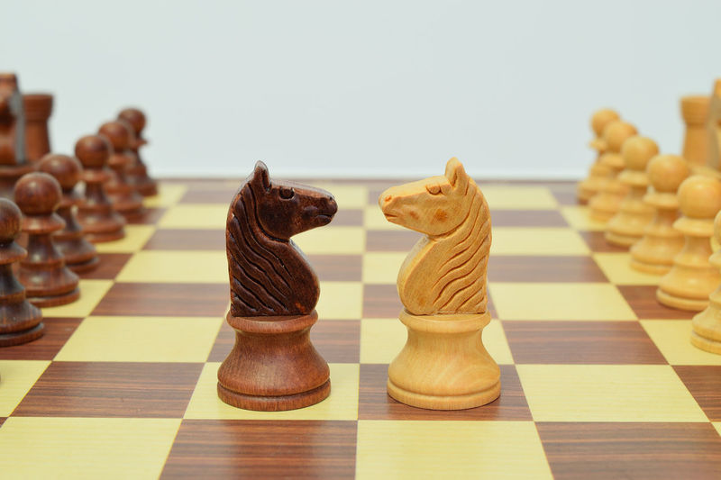 Close-up of chess against white background