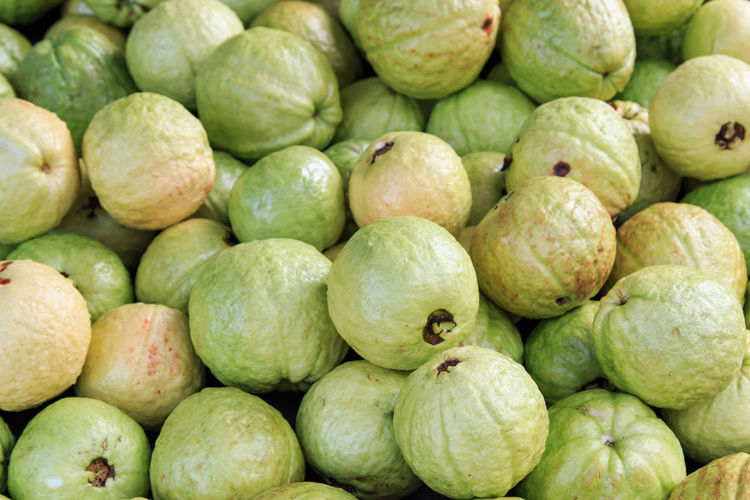 Full frame shot of guavas for sale at market stall