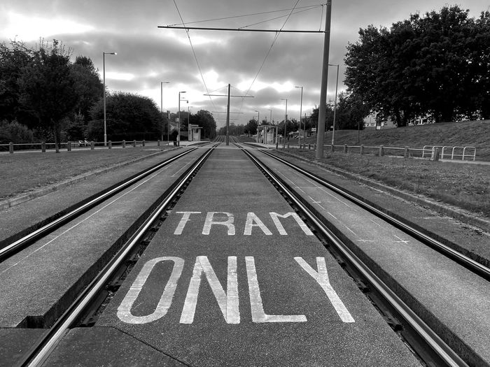 View of empty railroad tracks against sky