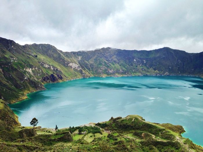 View of Laguna Quilotoa against cloudy sky