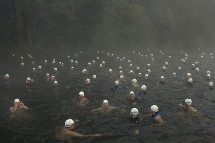 High Angle View Of Men Swimming In Hot Water Pond