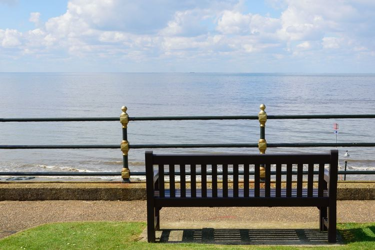 Empty bench overlooking sea Water Horizon Over Water Nature Beauty In Nature Tranquility Bench Tranquil Scene No People Promenade Park Bench Sea Empty Rails Overlooking Overlooking The Sea Wooden Vintage Sky Horizon Railing Scenics - Nature