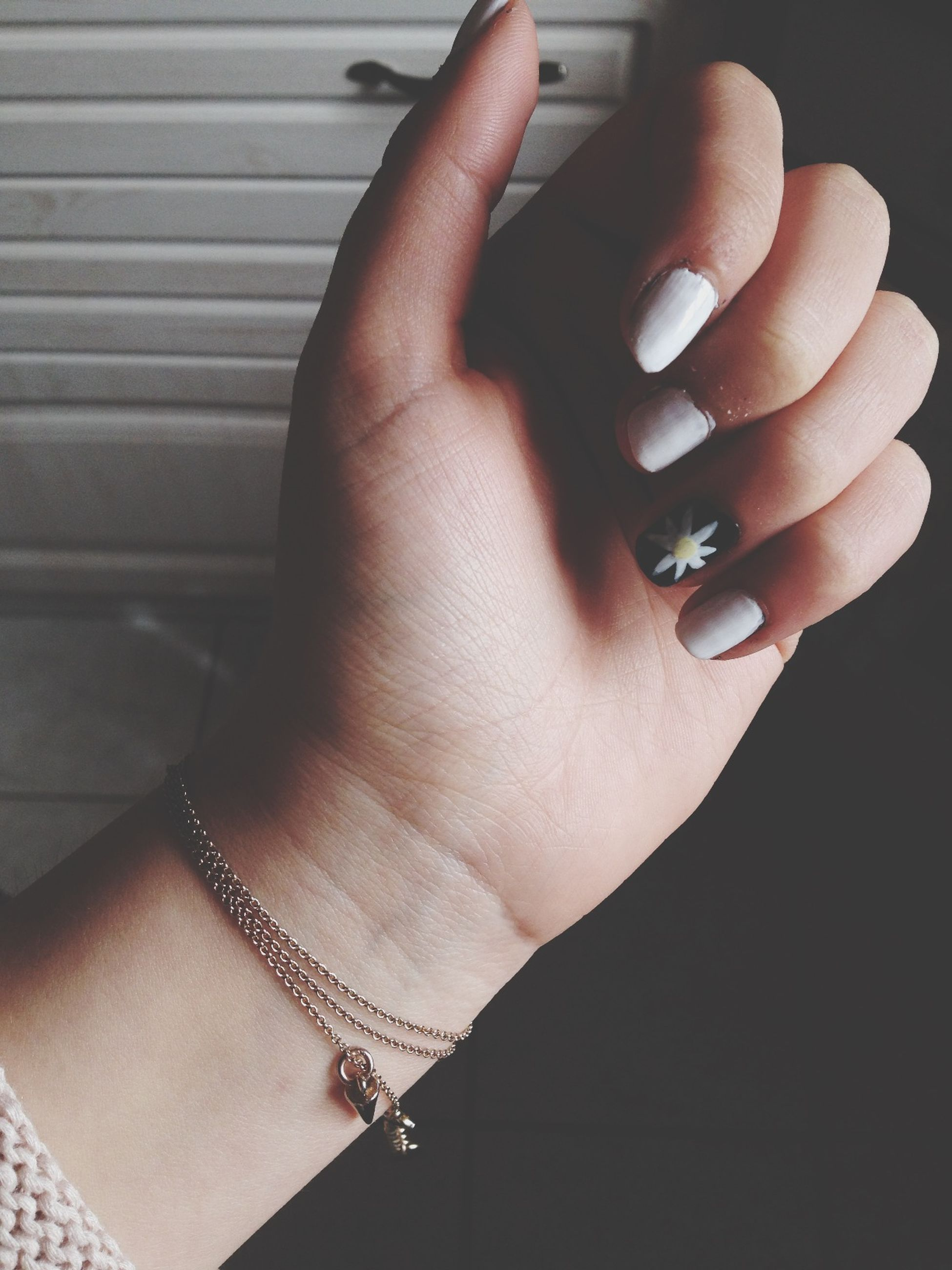 person, part of, human finger, indoors, close-up, cropped, holding, ring, personal perspective, jewelry, fashion, high angle view, nail polish, unrecognizable person, palm, human skin