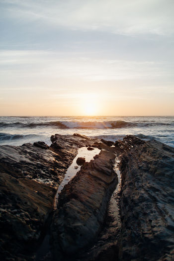 Beach Beauty In Nature Cloud - Sky Horizon Horizon Over Water Land Motion Nature No People Ocean Rock Rock - Object Scenics - Nature Sea Sky Solid Sunset Tranquil Scene Tranquility Water