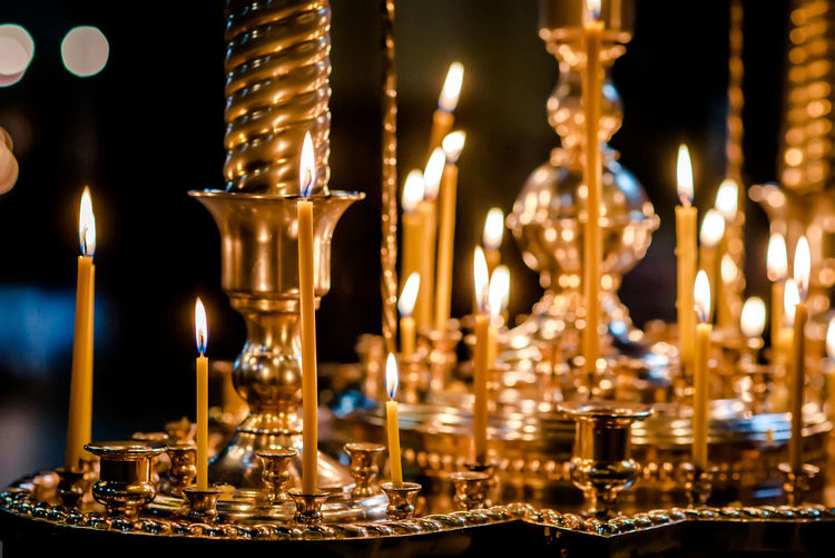 Close-Up Of Burning Candles On Altar In Church