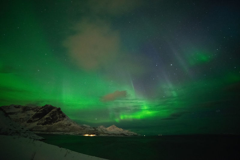 Aurora Borealis over Grøtfjord Geomagnetic Disturbance Kp-index Northern Lights Polar Lights Astronomy Aurora Polaris Beauty In Nature Cold Temperature Geomagnetic Storm Green Color Idyllic Illuminated Mountain Nature Night Non-urban Scene Scenics - Nature Sky Solar Storm Space Star - Space Tranquil Scene Tranquility Water Winter