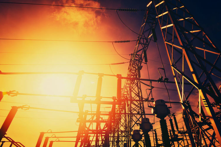 Main Power Plant Energy ideas And energy saving Sunset Sky Orange Color Nature Architecture Industry Outdoors Metal Low Angle View Built Structure Silhouette Construction Industry Sunlight Cable Construction Site Men Electricity  Fuel And Power Generation Occupation Real People Power Supply