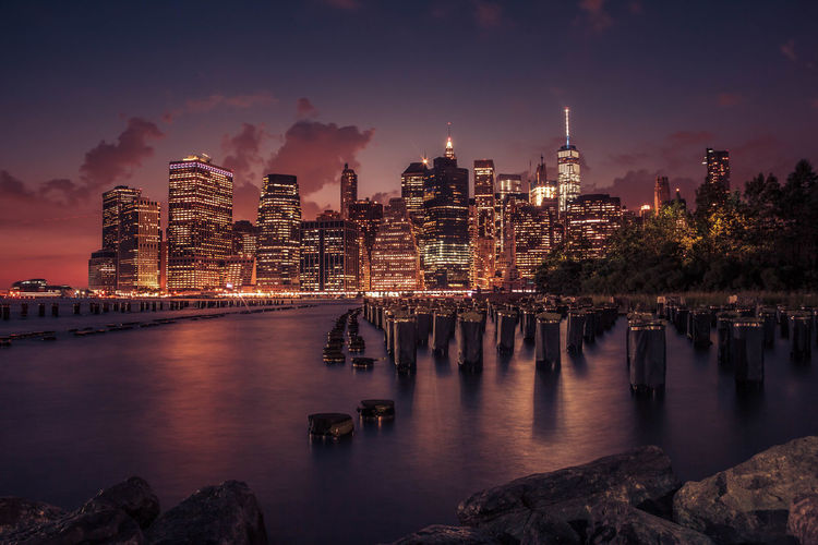 A view of the Manhattan Skyline from Brooklyn Bridge Park. Architecture Architecture_collection Brooklyn Brooklyn Bridge Park Illuminated Long Exposure Manhattan Skyline Night Night Photography Nightphotography No People NYC Reflection Skyline Sunset Water