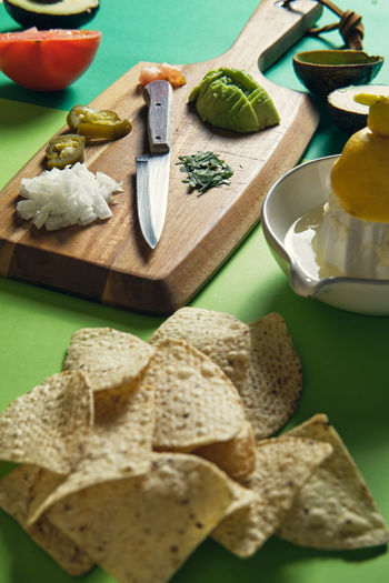 Close-up of chopped fruits on cutting board