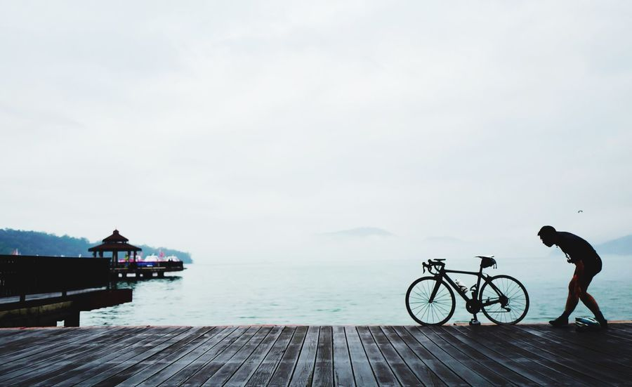 Watch me Bicycle Sea Sky Water Nature Mode Of Transport Outdoors Full Length Day One Person Real People Scenics Men Beauty In Nature Architecture