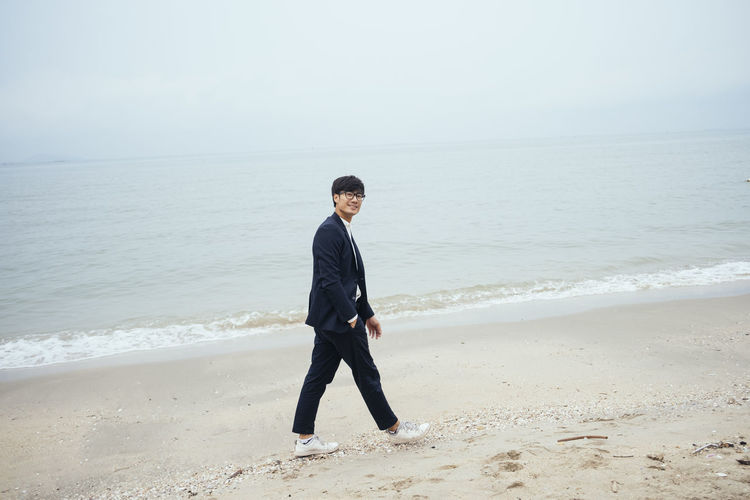 Full length of young man on beach