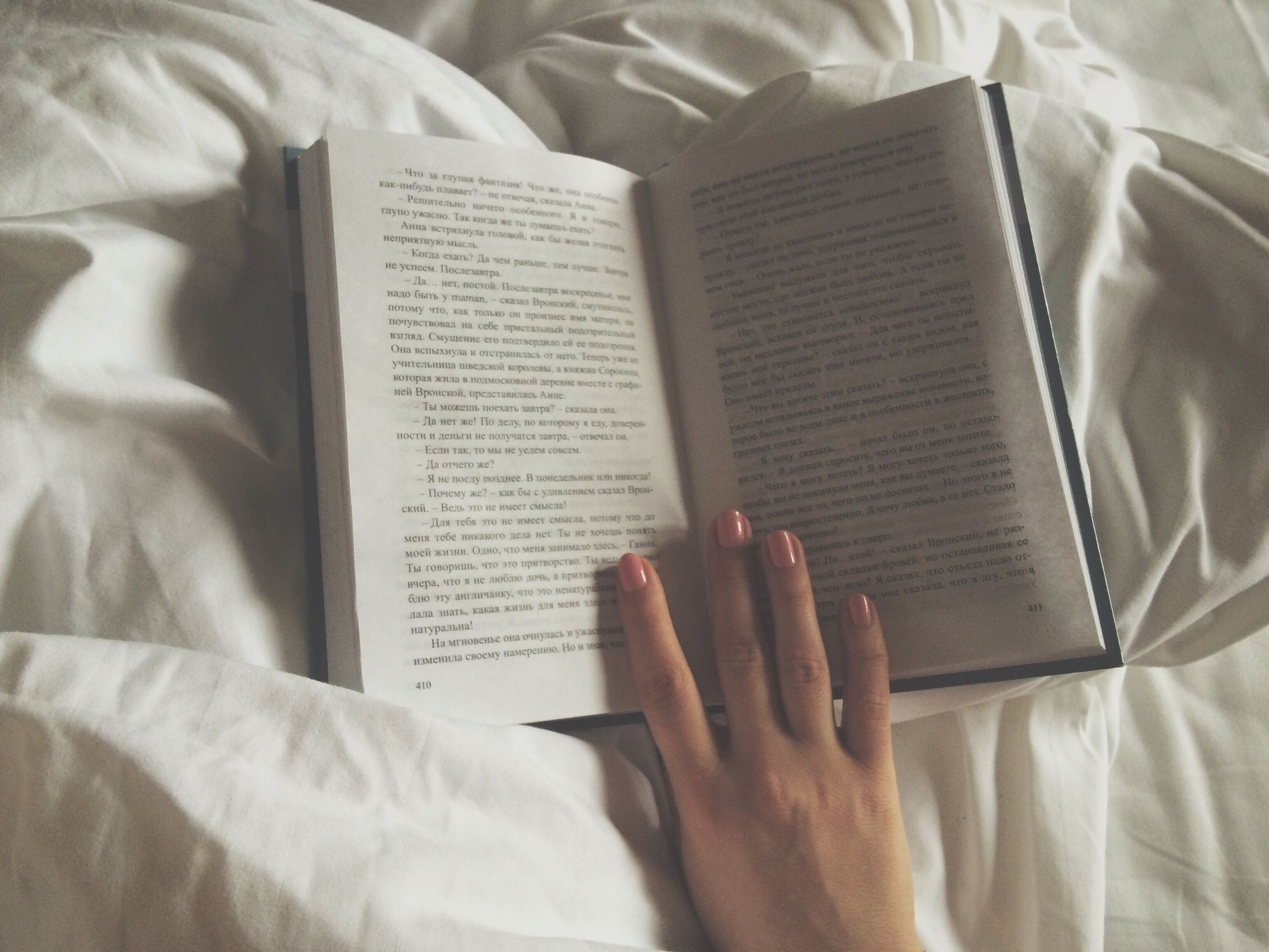 indoors, person, holding, part of, book, communication, human finger, lifestyles, cropped, text, midsection, men, education, paper, bed, unrecognizable person