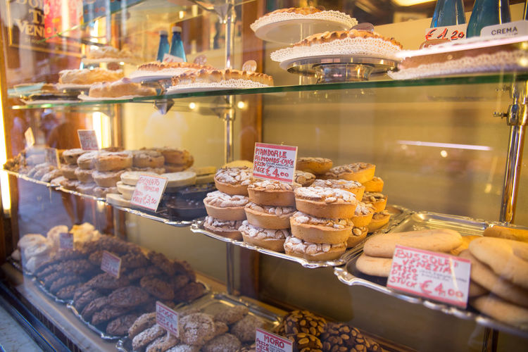 Products displayed in cabinet at bakery