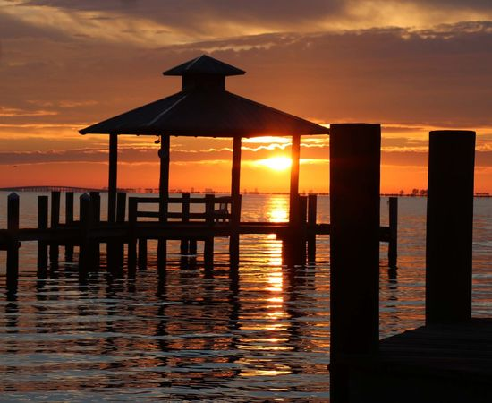 November's sunrise on the docs Beauty In Nature Built Structure Horizon Over Water Nature Orange Color Sea Silhouette Sky Tranquil Scene Tranquility Water Be. Ready.