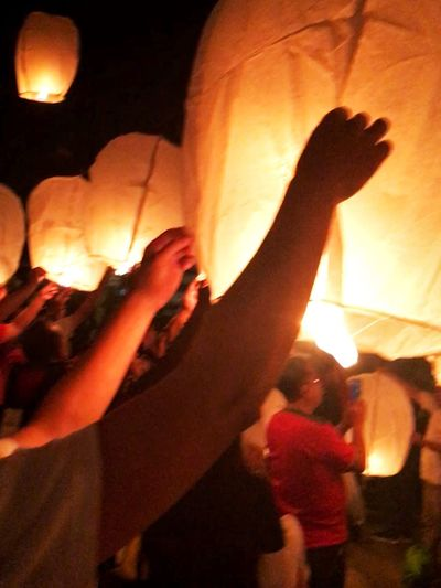 Flying lantern Real People Men Night Lifestyles Leisure Activity Indoors  Illuminated Women Standing Togetherness Human Hand Friendship Close-up Sky People Lantern Festival Popular Photos Flying High