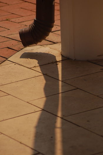 Downspout Downspout Shadow Downspouts Downspoutstart Little Moments Man Made Object No People Outdoors Pavement Relaxing Relaxing Moments Relaxing Photos Shadow Shadow And Light Shadow Play Spout Spout Shadow Sunny Tranquil Scene Tranquility