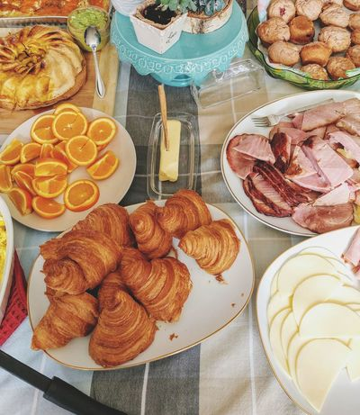 Easter brunch with family Cheese Ham Dessert Table Directly Above Baked Cupcake Close-up Sweet Food Croissant Butter Knife Mozzarella