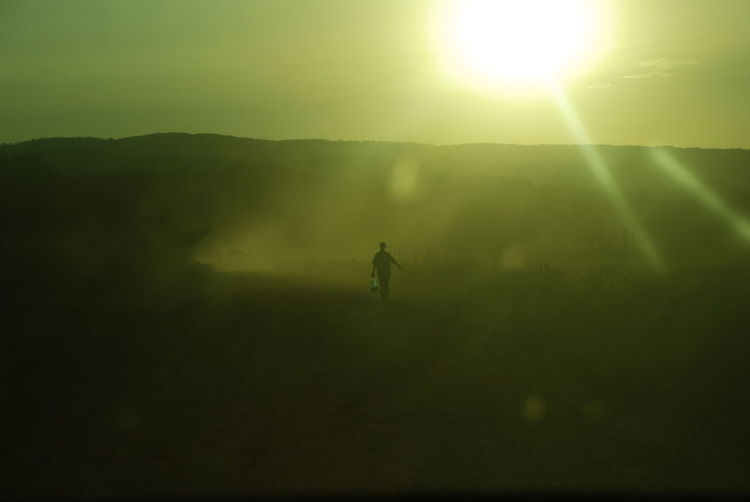 Africa Arid Climate Arid Landscape Atmosphere Atmospheric Mood Barren Clear Sky Desert Dust Flying Glowing Horizon Over Land Landscape Light Majestic Mystery Outdoors Remote Sand Sand Dune Sun Flare Sunset Unrecognizable Person Water