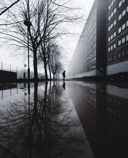 Reflection of man on water