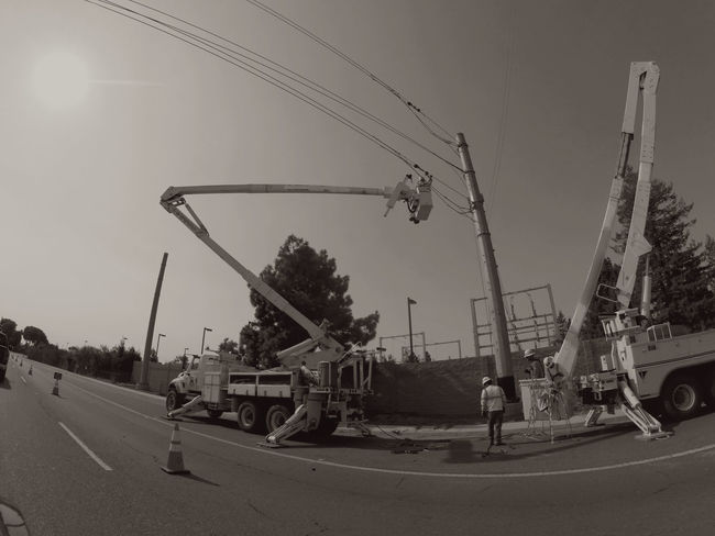 Taking Photos Drivebyphotography Monochrome Power Lines Heavy Equipment People Working Working Perspective Telephone Pole Power Line  HardHats