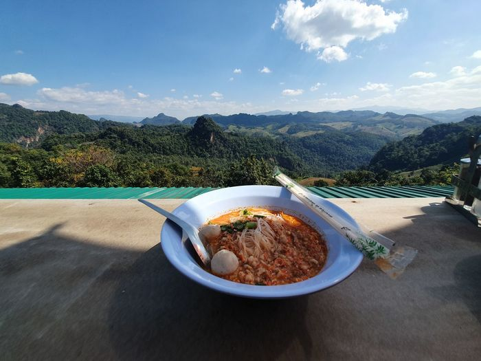 High angle view of food on table against mountains