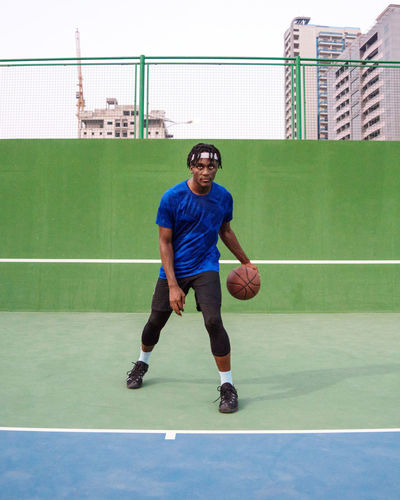 Portrait of the black man with the basketball