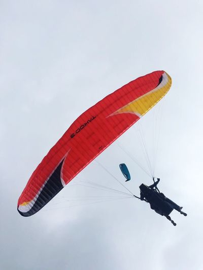 People paragliding in sky