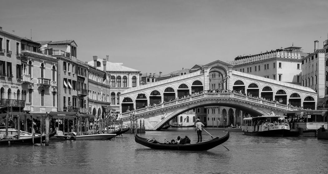 Boat Man Cityscape Venezia Arch Bridge Architecture Blackandwhite Boat Bridge Bridge - Man Made Structure Building Exterior Built Structure Canal City Gondola - Traditional Boat Italy Mode Of Transportation Monochrome Nature Nautical Vessel Rialto Transportation Travel Travel Destinations Venice Water Waterfront
