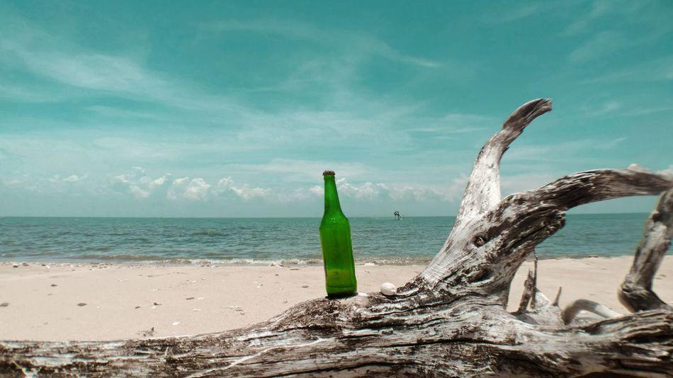 瓶 Beach Sand Sea Social Issues Green Color Landscape Nature Day Sky Water Outdoors No People Horizon Over Water Sand Dune