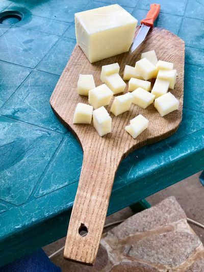 Yellow cheese on wooden board Food And Drink High Angle View Food Indoors  Freshness Cheese Preparation  Dairy Product Still Life No People Cube Shape Cutting Board Table Day Close-up