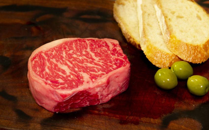 Food Freshness Meat Red Meat No People Still Life Raw Food Beef SLICE Cutting Board Beef Steak Beefsteak Steak Raw Beef Raw Meat   Bread Olive Cooking Food Preparation