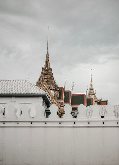 View of temple building against cloudy sky