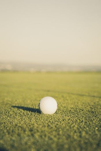 Close-Up Of Golfball On Field