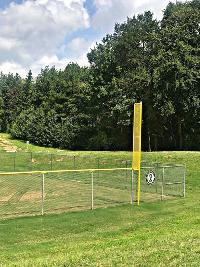 Softball field foul line and 300 ft mark. Trees Sport Grass Foul Pole Foul Line Softball Softball Field Sky Playing Field Field No People Outdoors Cloud - Sky Day Team Sport Fence Softball Rules public park