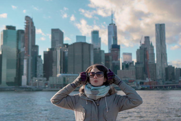 Cold Temperature Cold Weather Winter Wintertime Girl One Young Woman Only Manhattan City Life New York Skyline  NYC NYC Photography Sky Clouds Sunny Portrait Blur Focus On Foreground City Cityscape Urban Skyline Skyscraper Water Standing Beautiful Woman Financial District  Tall - High Tower Skyline Tourist Attraction  Downtown District My Best Photo International Women's Day 2019
