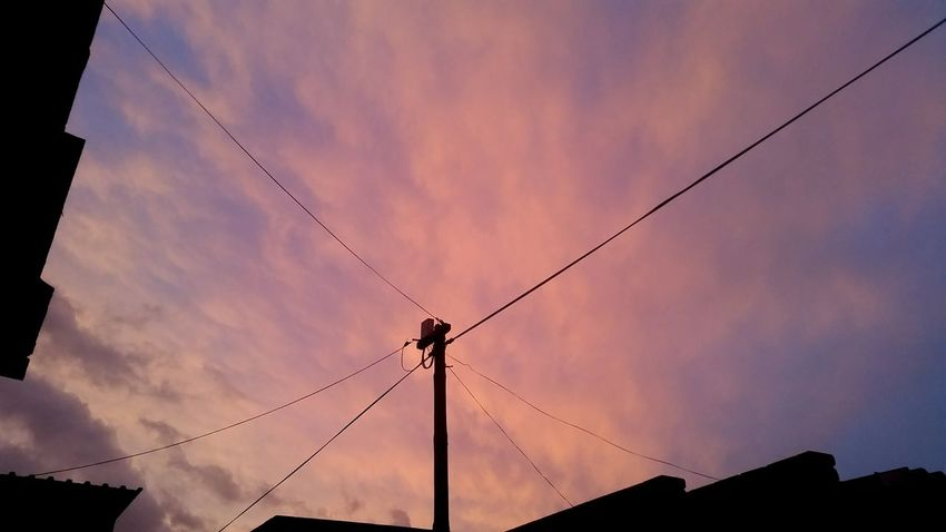 Electricity  Silhouette Sunset Dusk Connection Cloud - Sky No People Power Supply Sky Cable Power Line  Low Angle View Outdoors Storm Cloud Beauty In Nature Nature Thunderstorm