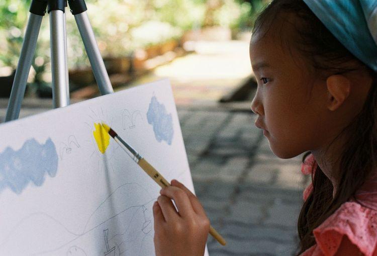 Portrait of girl holding paper