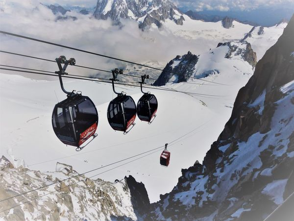 Beauty In Nature Cable Cloud - Sky Cold Temperature Hanging Low Angle View Mont Blanc Mountain Mountain Range Nature Outdoors Overhead Cable Car Ski Lift Sky Snow Winter