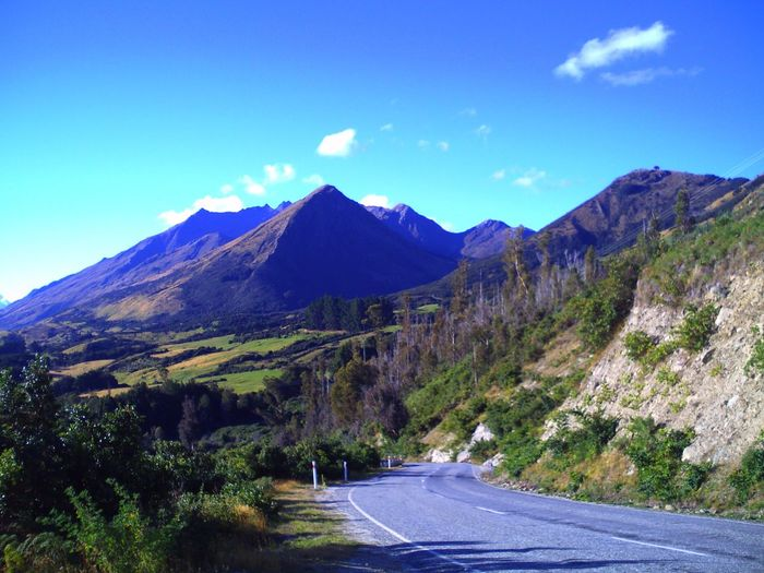 EyeEmNewHere Non-urban Scene Eye4photography  Mountain Scenics Blue Beauty In Nature Mountain Range Nature Sky Road Tranquility Day Transportation Landscape Tranquil Scene No People Idyllic Outdoors The Way Forward Mountain Road Winding Road Lake Scenery Travel Destinations