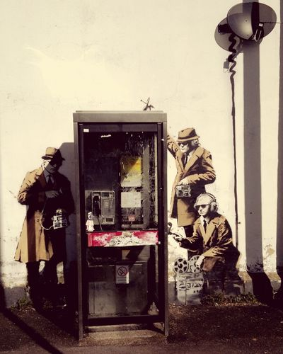 Technology Communication Telephone No People Day Outdoors Banksy Banksyart Cheltenham Graffiti Graffiti Art Wall - Building Feature Wallart Building Exterior Spying Listening Telephone Booth Telephone Box Recording Recording Equipment