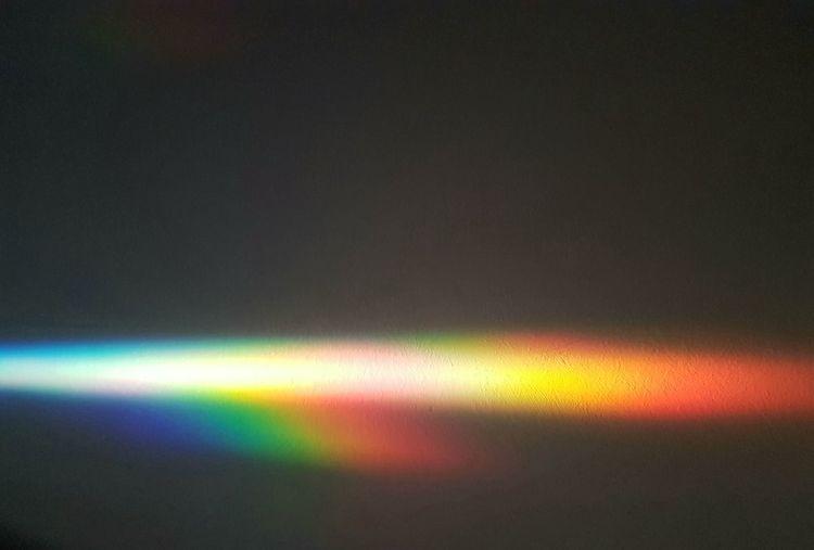Defocused image of rainbow in the dark