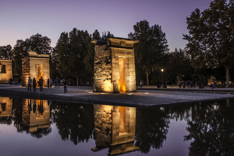 Reflection of temple of debod in water at dusk