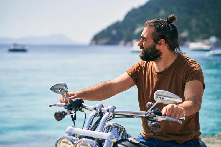 Man riding bicycle in sea