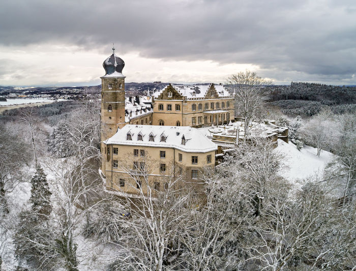 Air view of the Callenberg Palace in Coburg, Bavaria, Germany Architecture, Castle, Coburg, Editorial, Europe, European, Garden, Germany, Historic, Landmark, Old, Outdoors, Palace, Park, Plants, Stone, Street, Traditional, Travel, Urban Built Structure Architecture Building Exterior Snow Cloud - Sky Cold Temperature Winter Sky Building Nature Water No People Day Tower Religion Plant Belief Spirituality Outdoors