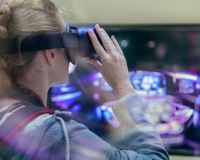 Mid adult woman using virtual reality at home