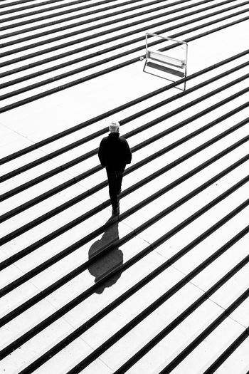 High angle view of man moving up steps
