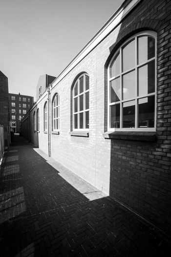 Shadow play Architecture Built Structure Building Exterior Building Window Day City No People Sky Nature Residential District Outdoors Arch Street Footpath House Direction Brick Clear Sky Wall Alley Row House