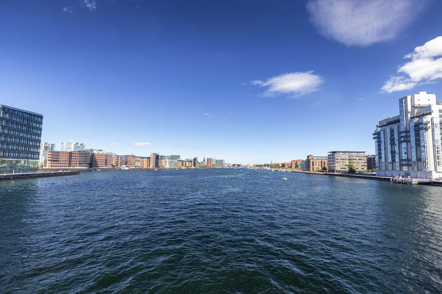 Wide angle view of a canal in Copenhagen, Denmark. Architecture Denmark Scandinavia Statue Swimming Tourist Attraction Canal Church Of Our Saviour Copenhagen Danish Destination Historical History Landscape Nyhavn Outdoors Red Fort Relax Rundetaarn Spire  Summer Swim Tourism Traditional